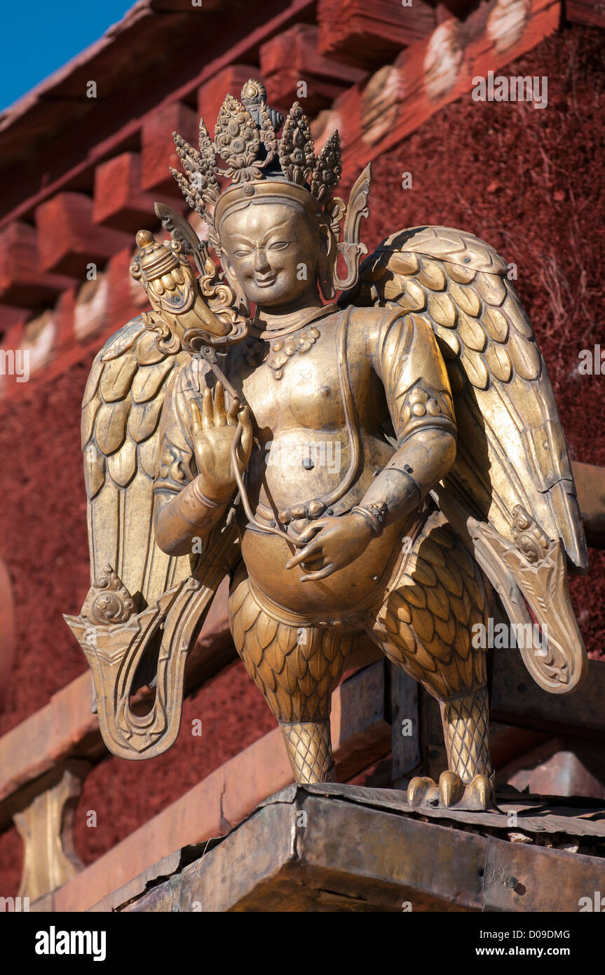 Golden mythical creature on roof of Tibet's most sacred Buddhist temple the Jokhang, Lhasa, Tibet, China - Stock Image