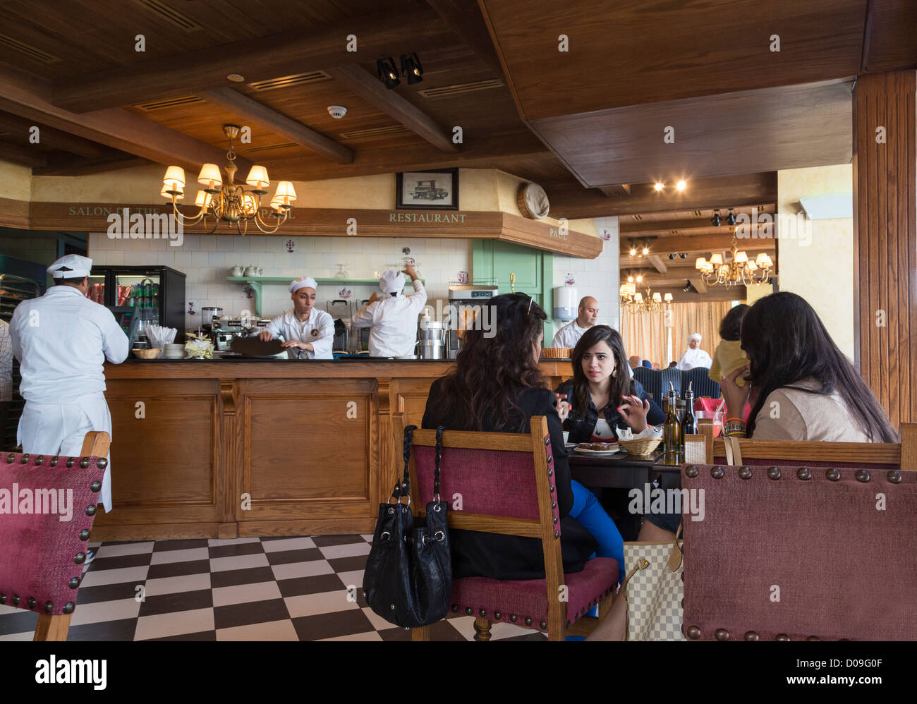 customers in Paul, restaurant and patisserie, Downtown mall, New Cairo, Egypt - Stock Image