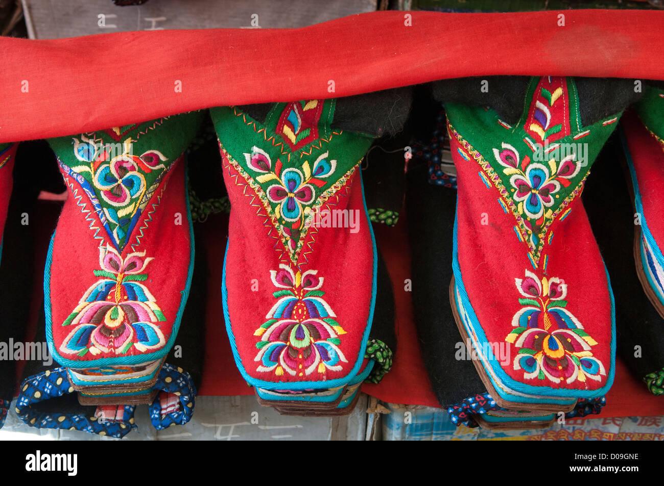 Embrodery boots at souvenir shop, Shigatse, Tibet - Stock Image