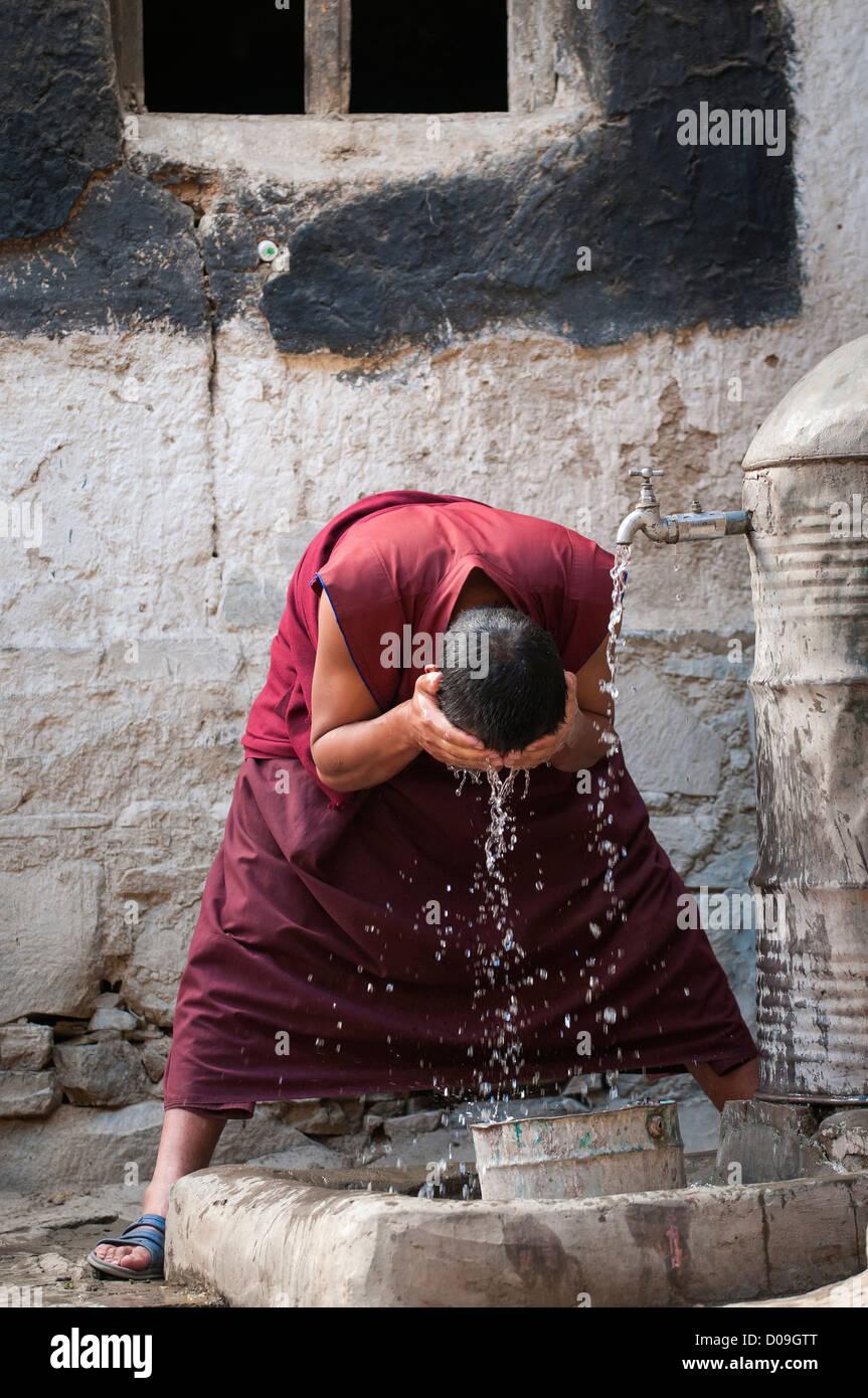 Buddhist monk washes face, Tashilhunpo Monastery, Shigatse, Tibet, China - Stock Image