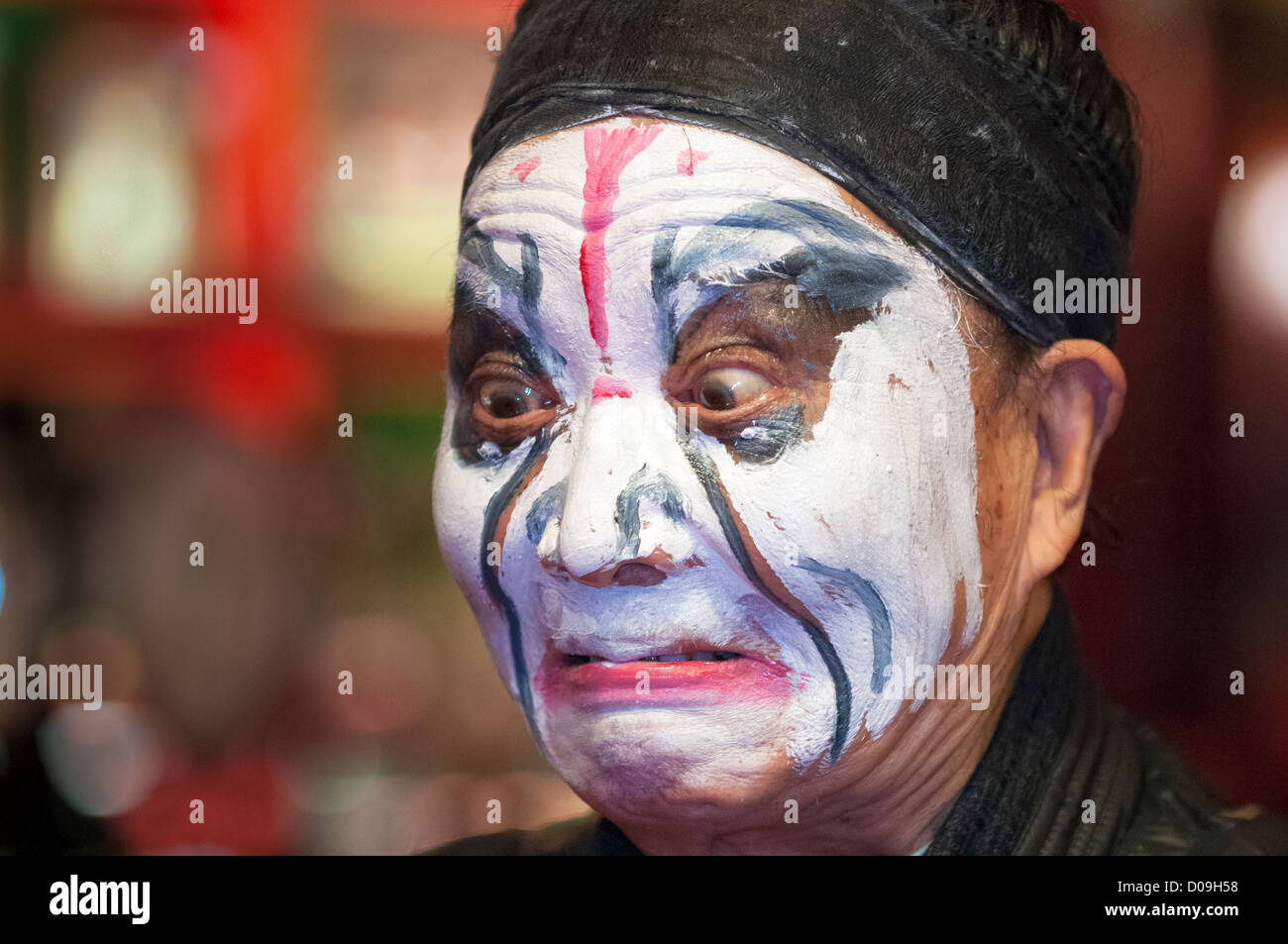 Performer inspects his makup in dressing room, Sichuan Opera at Shufenyayuan Tea House, Chengdu, Sichuan Province, - Stock Image