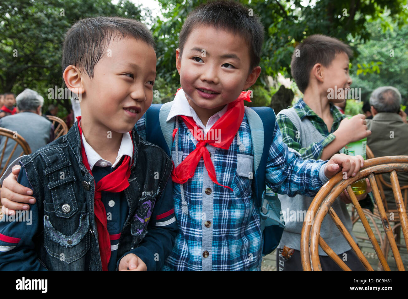 Boys are friends during school outing in Wenhua Park, Chengdu, Sichuan Province, China - Stock Image