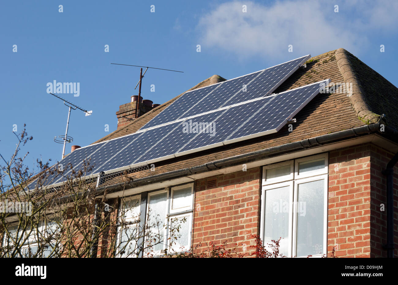 Solar Panels on modern council house roof. - Stock Image
