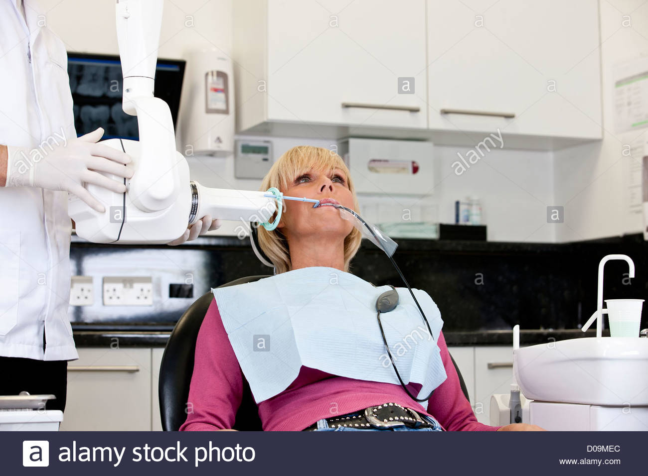 A female patient having an x-ray at the dentist - Stock Image