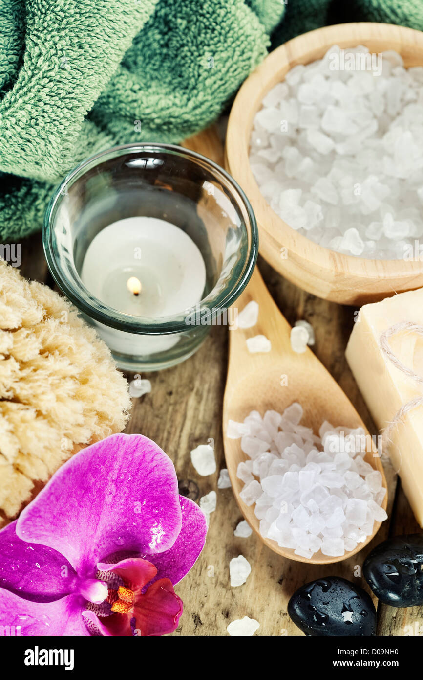 Spa Settings (zen stones, candle, towel, sea salt, soap and orchid) - Stock Image