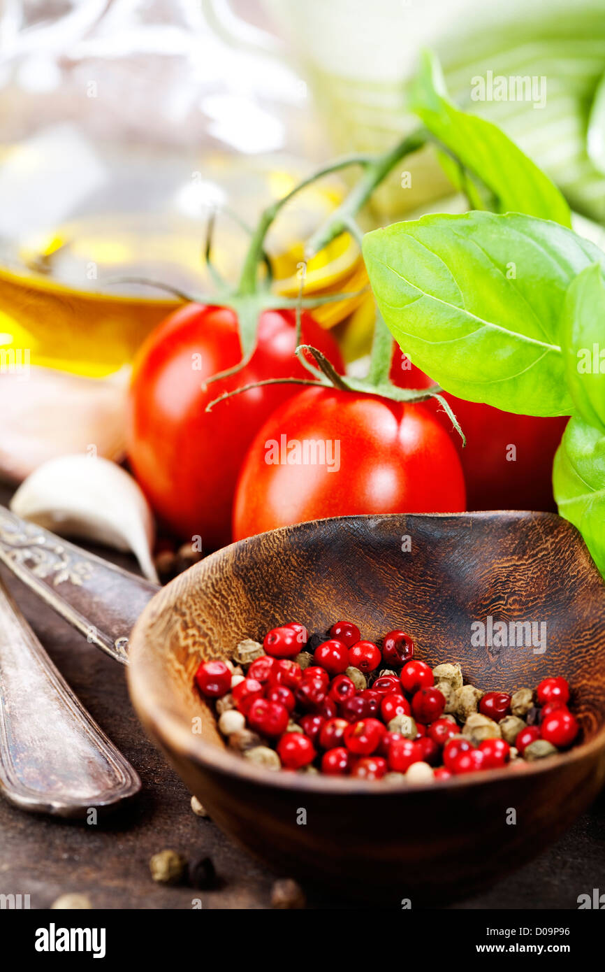 Several varieties of vegetables, olive oil and spices - Stock Image