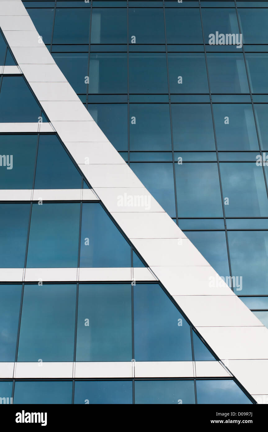 Blue sky reflected in the windows of office building Stock Photo