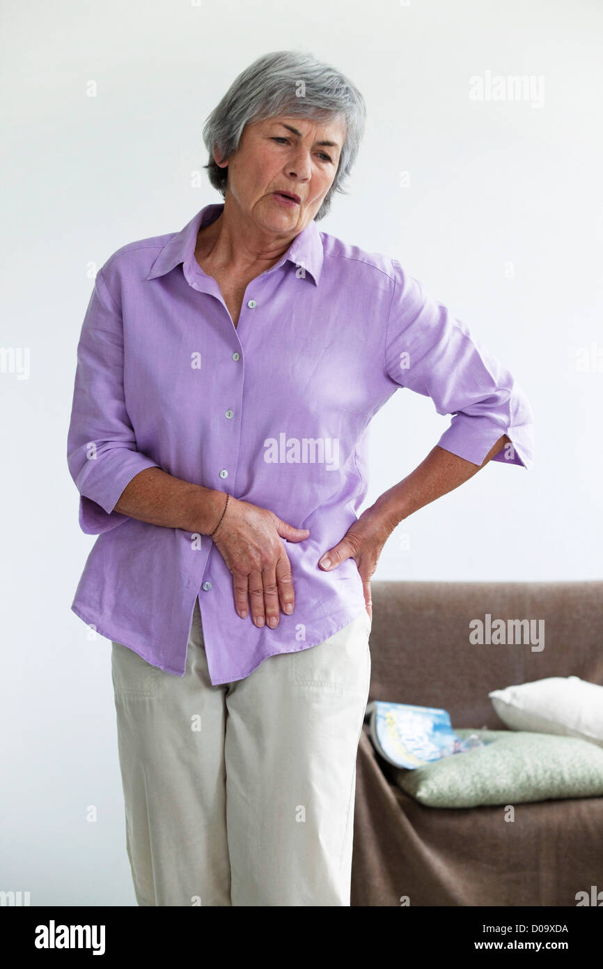 HIP PAIN IN AN ELDERLY PERSON - Stock Image