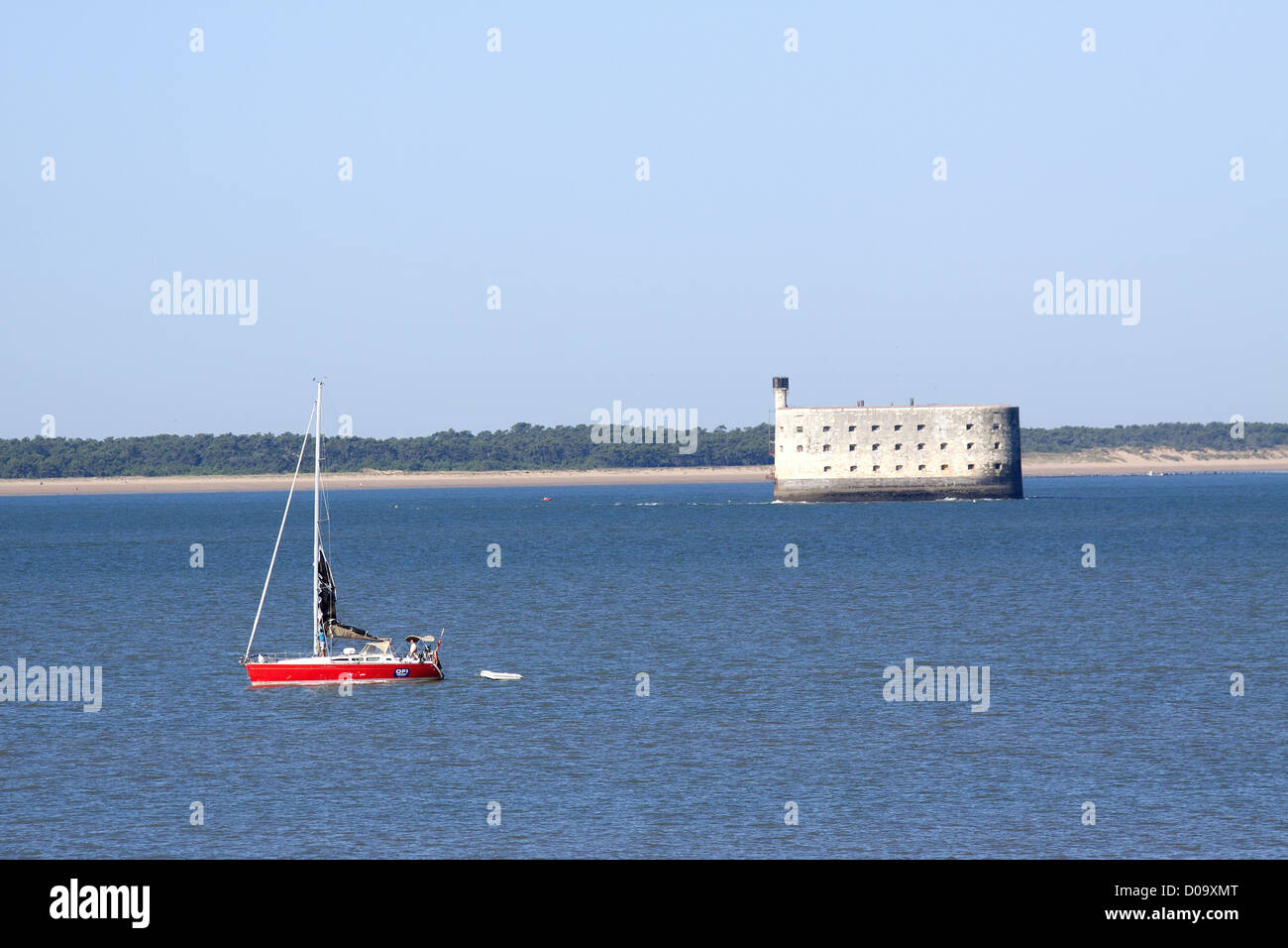 SAILBOAT DRIFTING ALONG FEW CABLE LENGTHS FROM FORT BOYARD ILE D'OLERON IN BACKGROUND CHARENTE-MARITIME POITOU - Stock Image