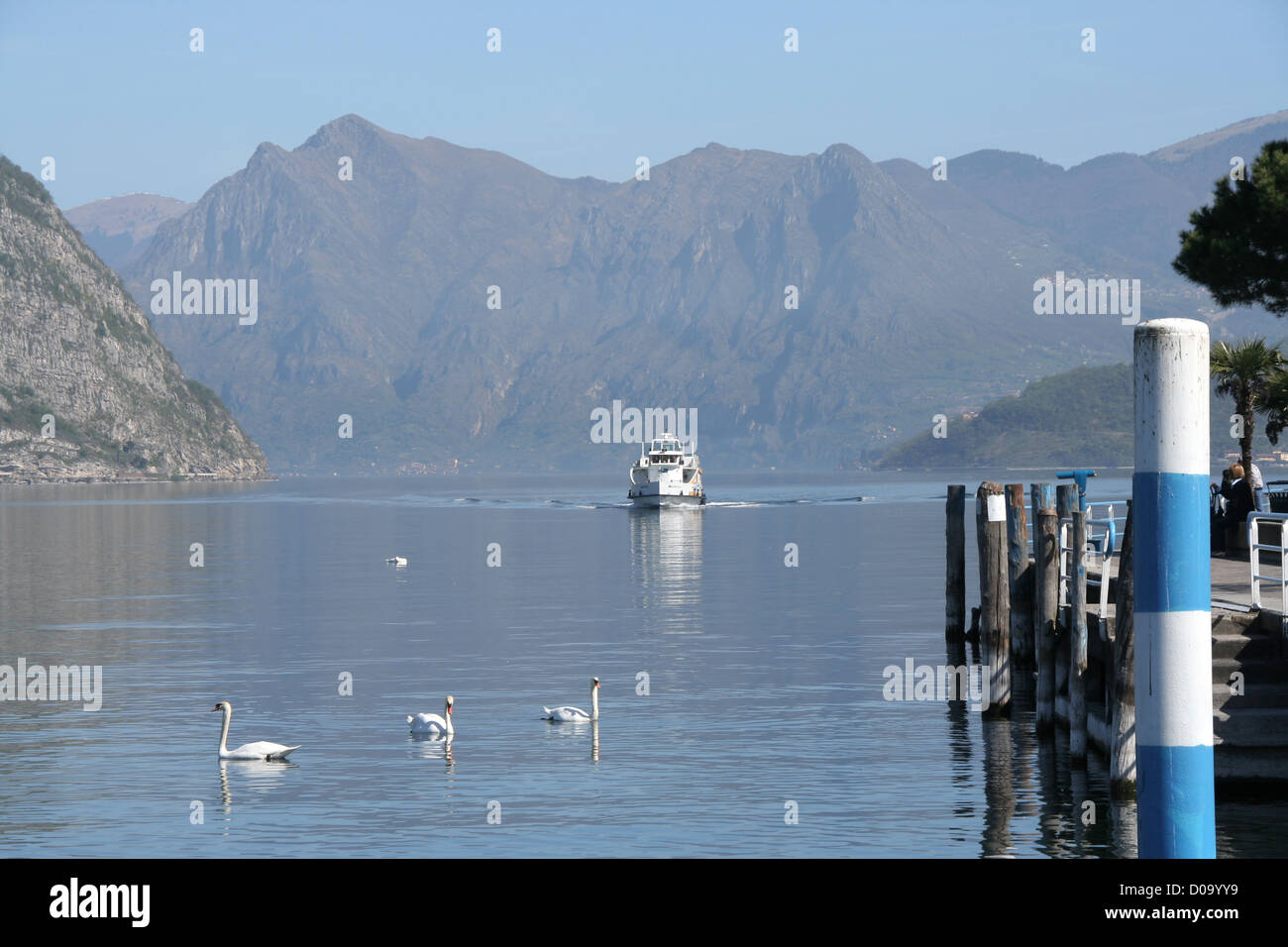 ferry on calm waters of Lago d'iseo, Italy - Stock Image