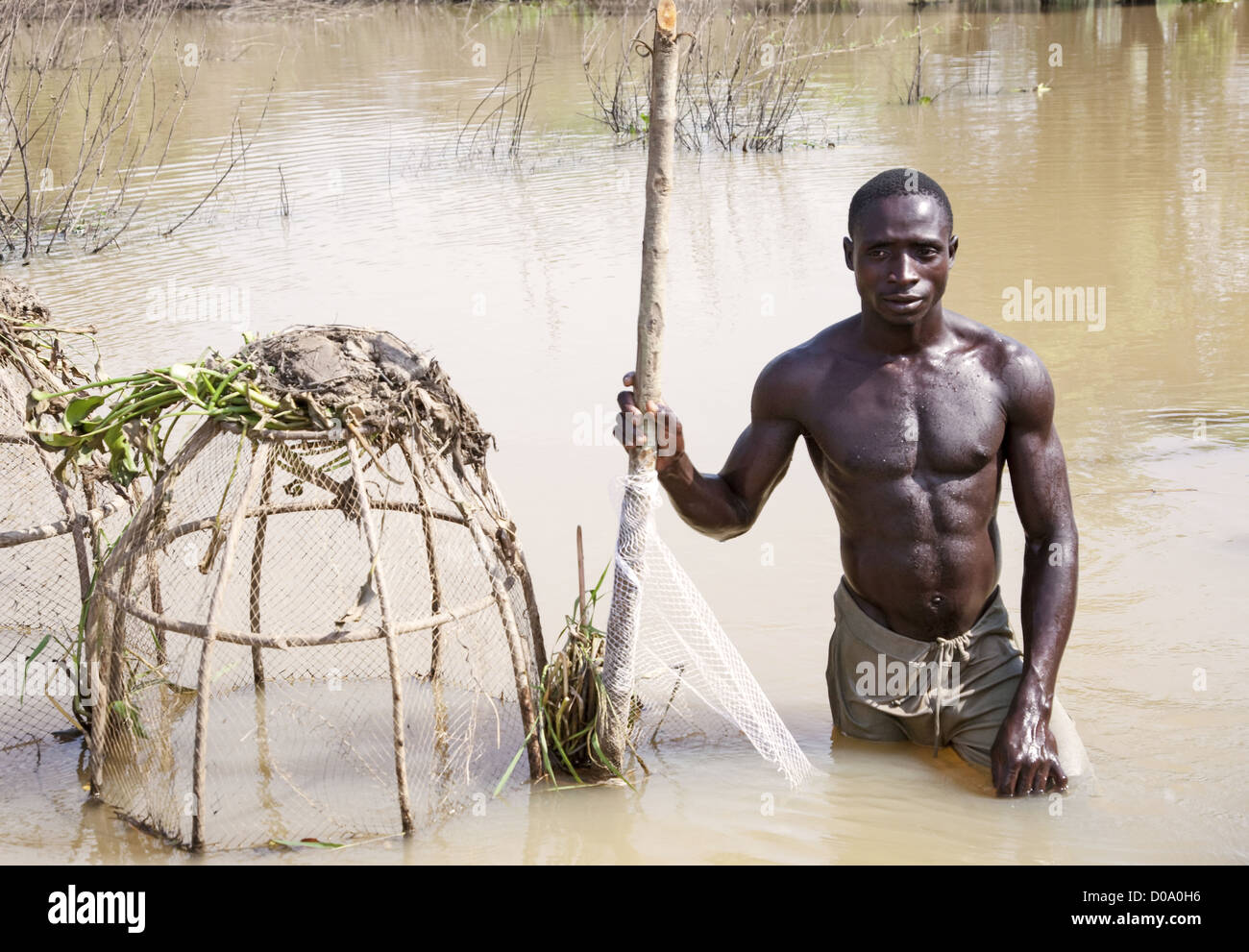 Portrait Of fisherman Fishing In River Niger, Kogi State, Nigeria - Stock Image