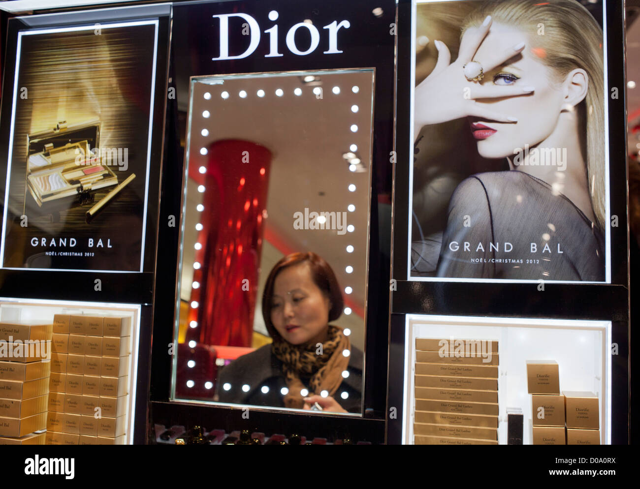 Chinese tourist trying Dior products in a shopping mall in Paris, France Stock Photo