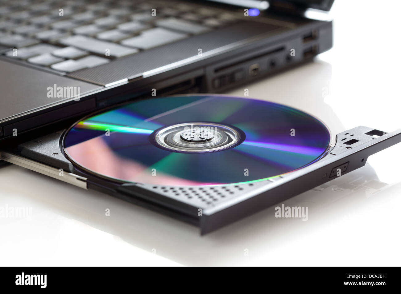 Inserting a blank CD - Stock Image