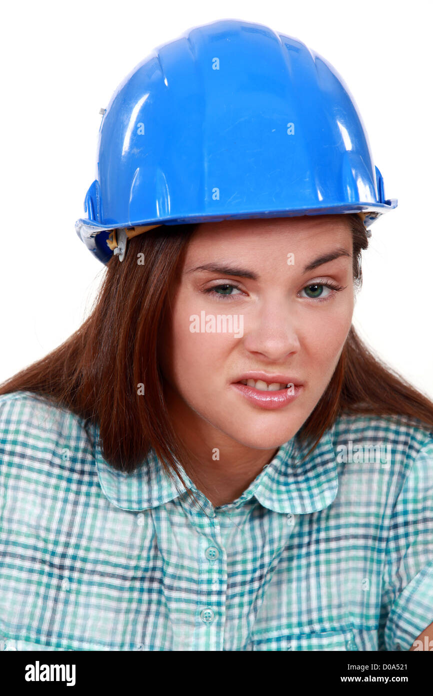 Young woman laborer grimacing - Stock Image