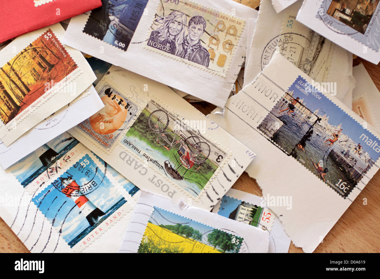 Postage stamps from around the world, varied and colorful - Stock Image