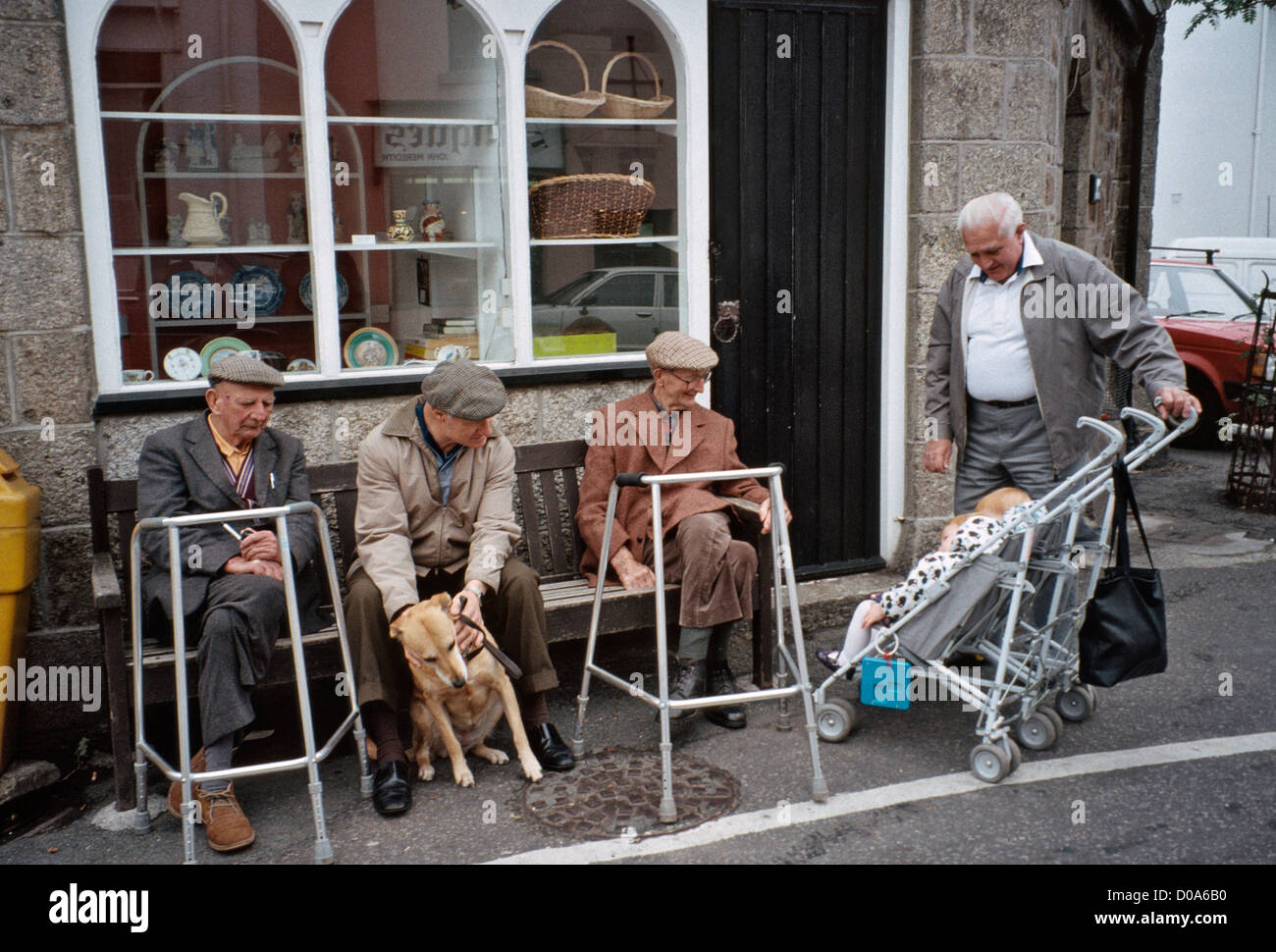grandfather with grand child visiting old men with zimmer frames ...