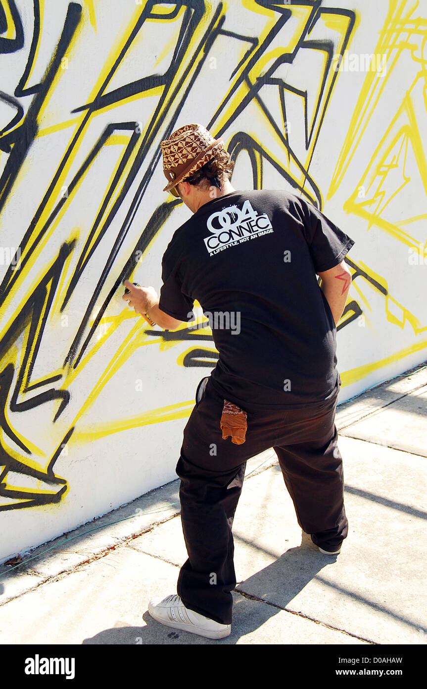 Ewoc one of new york world famous graffiti artists participate in scion trilogy building painting event at the so cool e venue