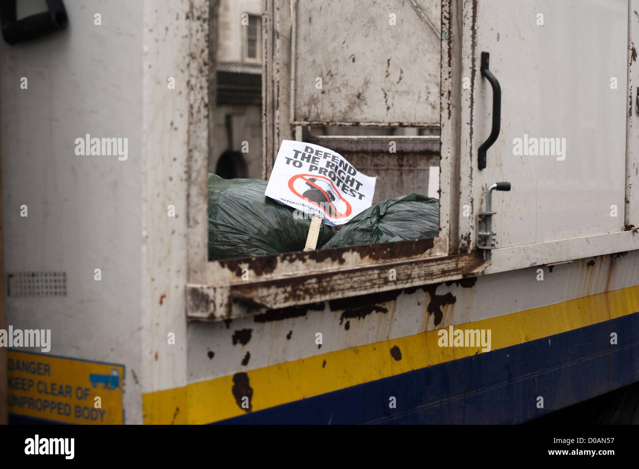 London, UK - 21 November 2012: a sign reading 'defend the right to protest' lays in a cleaning truck after - Stock Image