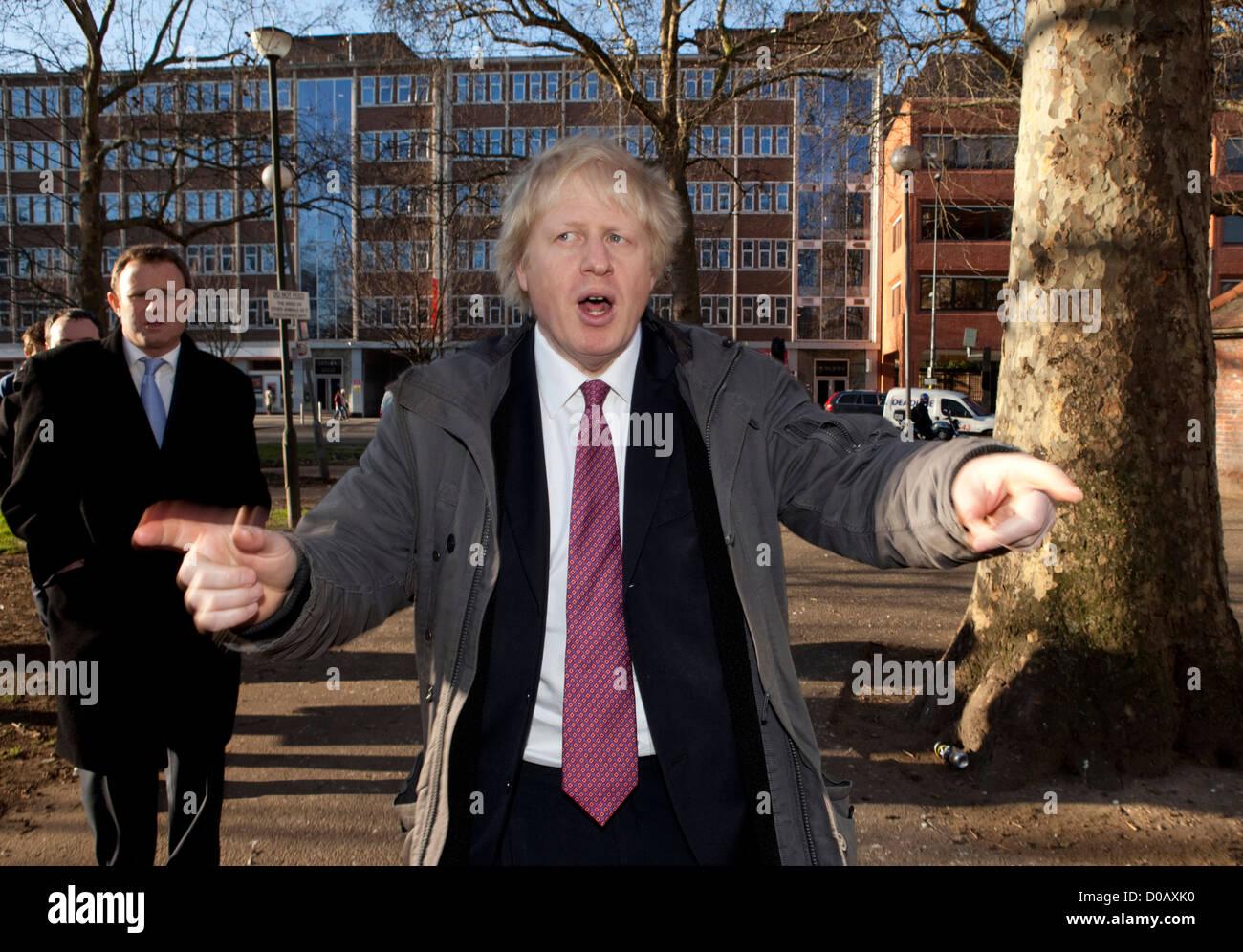 mayor of london Boris Johnson  joined a Safer Neighbourhood Team on a walk around shepherds Bush Market, london - Stock Image