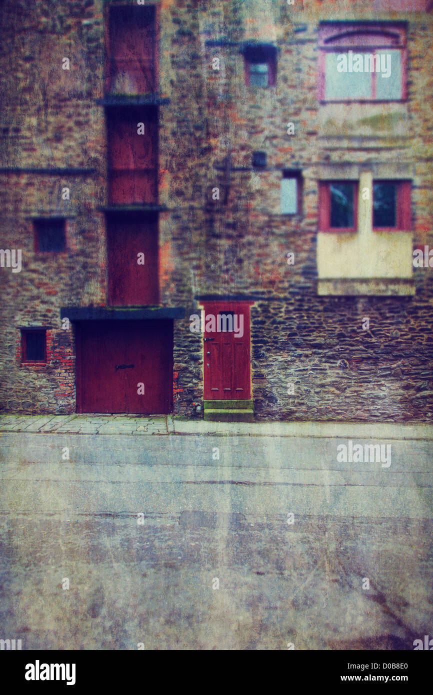 Old stone facade warehouse in Bristol, UK - Stock Image