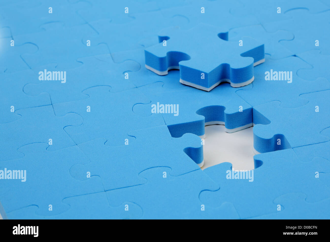 abstract puzzle background with one piece missing - Stock Image