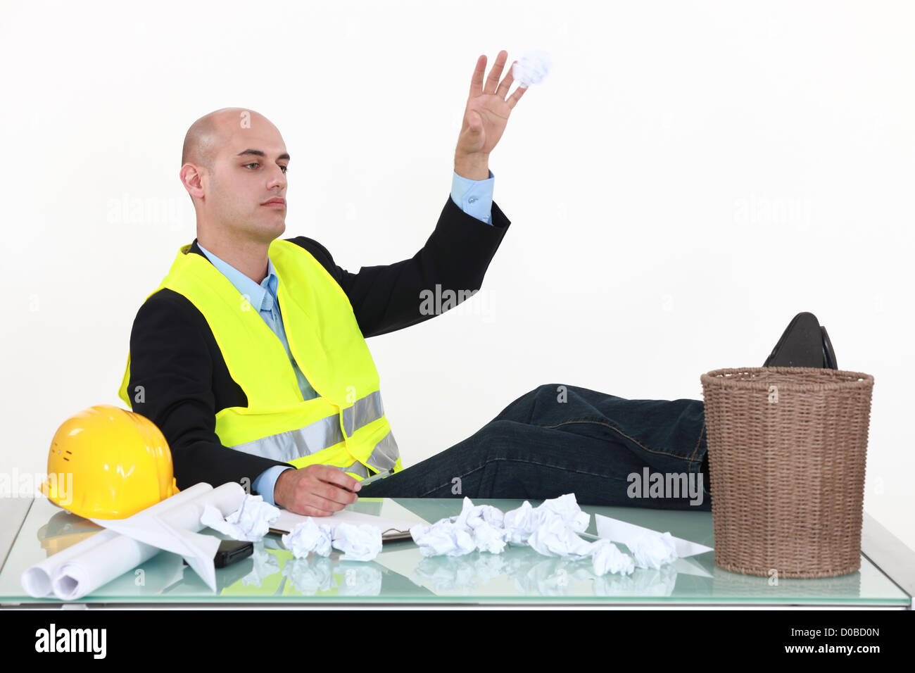 An architect throwing drafts in the garbage cans. - Stock Image
