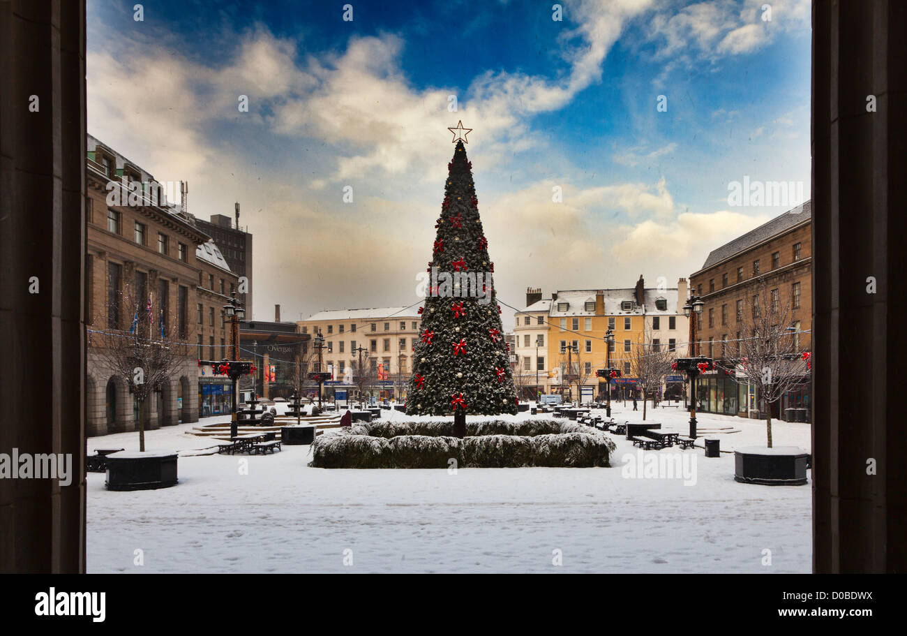 Dundee's Christmas Tree in the City Square under a blanket of snow - Stock Image