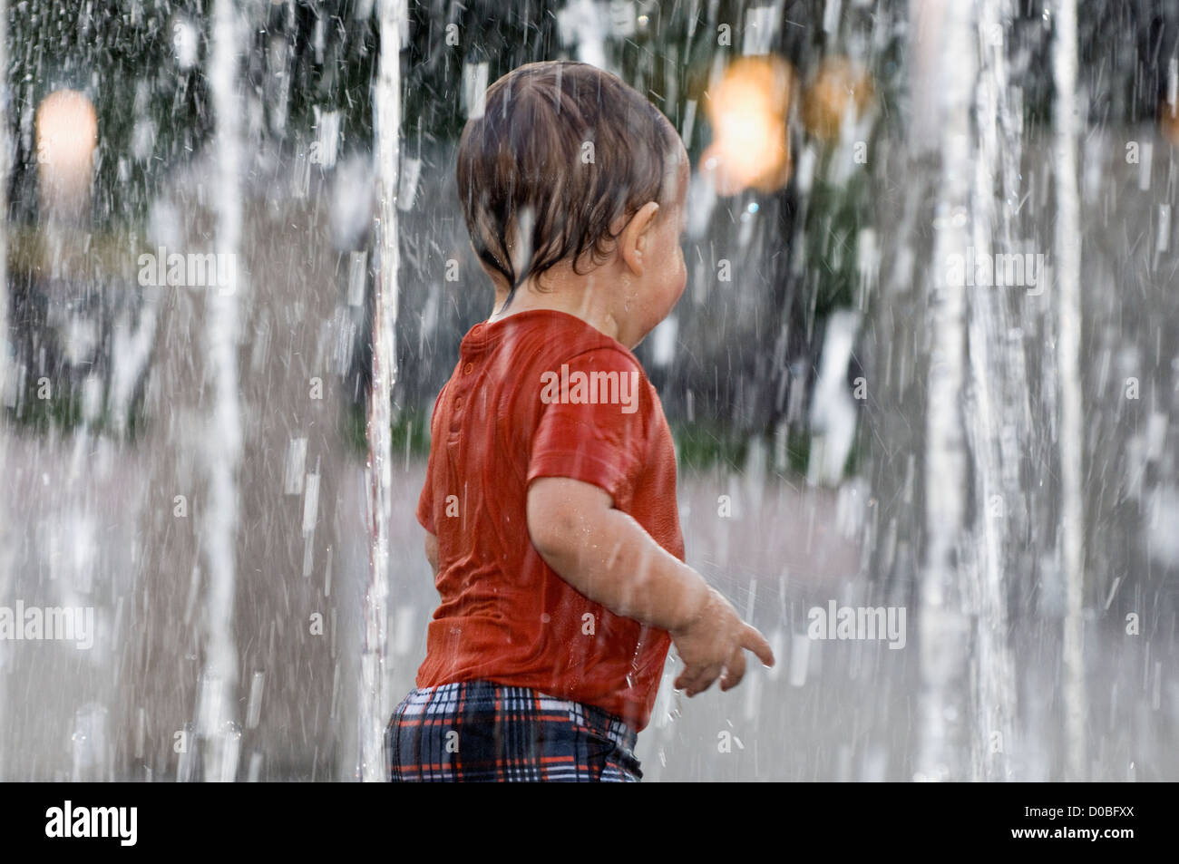 Toddler Playing in Fountain at Waterfront Park in Louisville - Stock Image