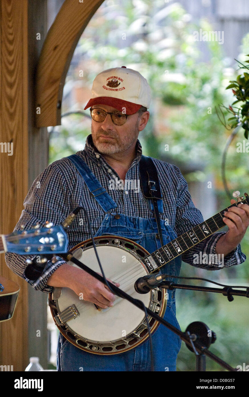 Musician with Banjo in the Matt Phelps and the River City Bluegrass Band Performing at a Bluegrass Festival at Hidden - Stock Image