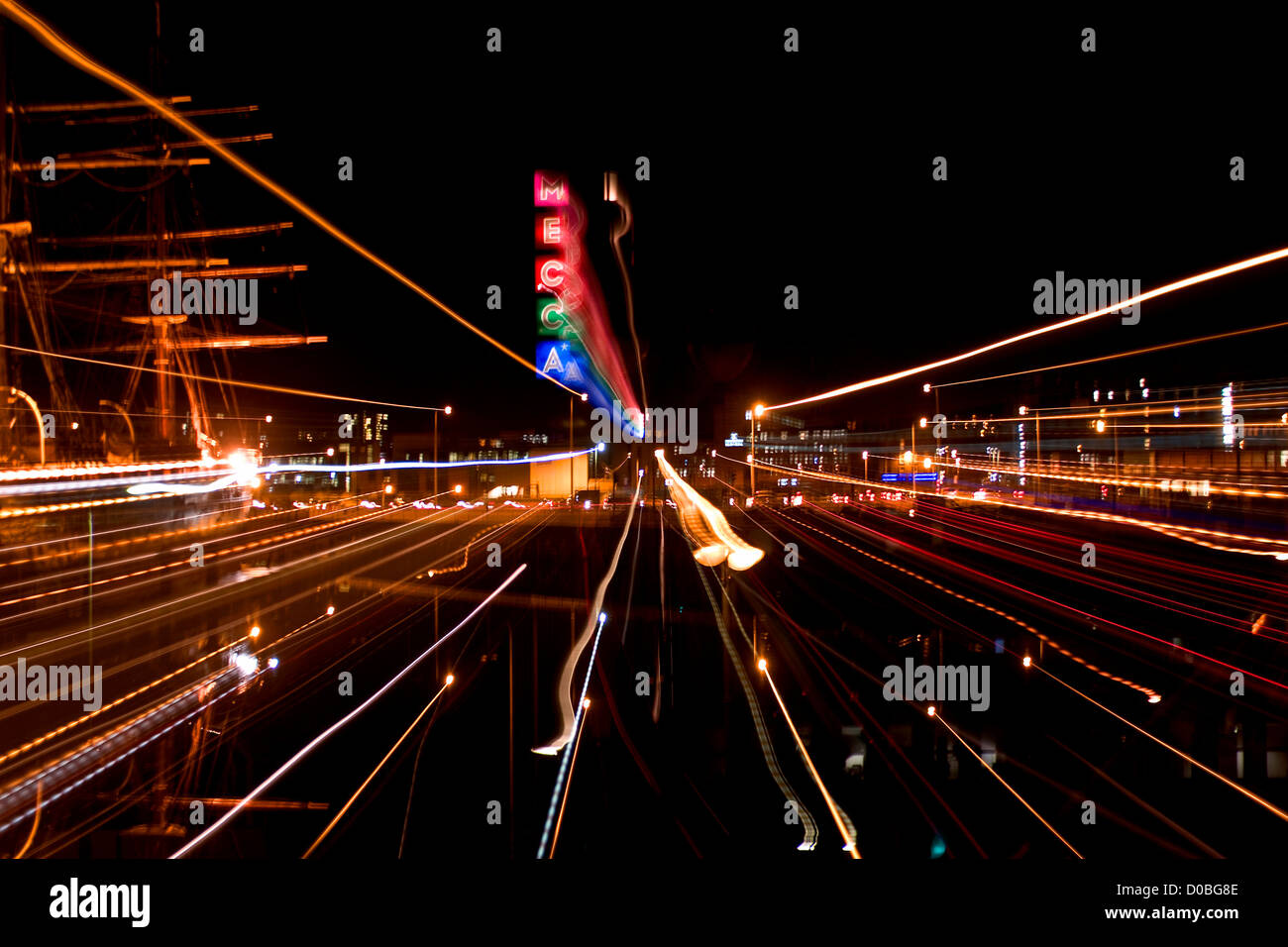 City and vehicle lights streaking across the city at night illuminating the sky over Dundee,UK - Stock Image