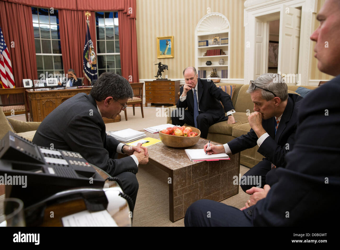 US President Barack Obama talks on the phone with Egyptian President Mohammed Morsi from the Oval Office of the - Stock Image