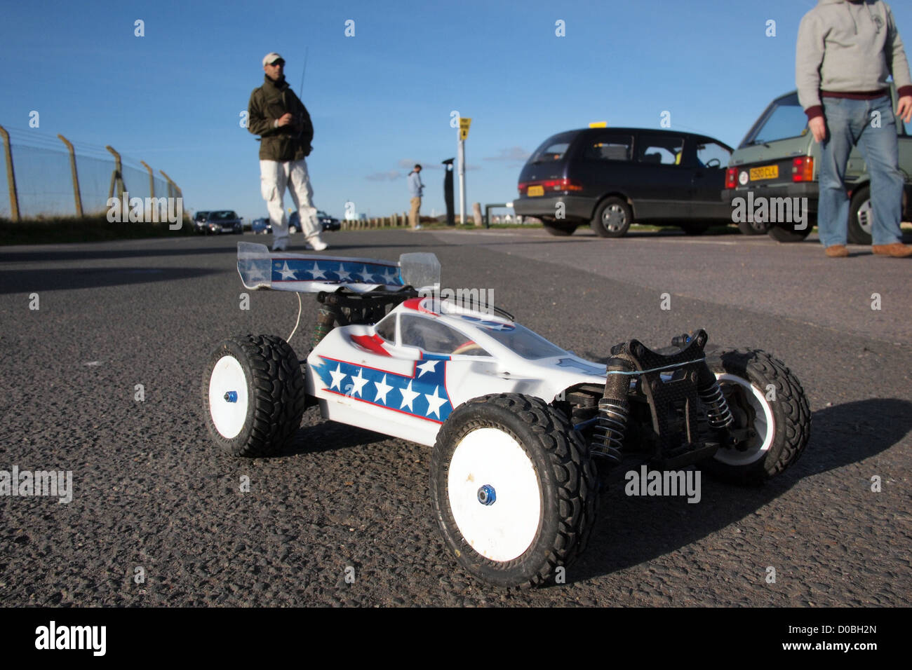 radio controlled RC car driving on beach england uk - Stock Image