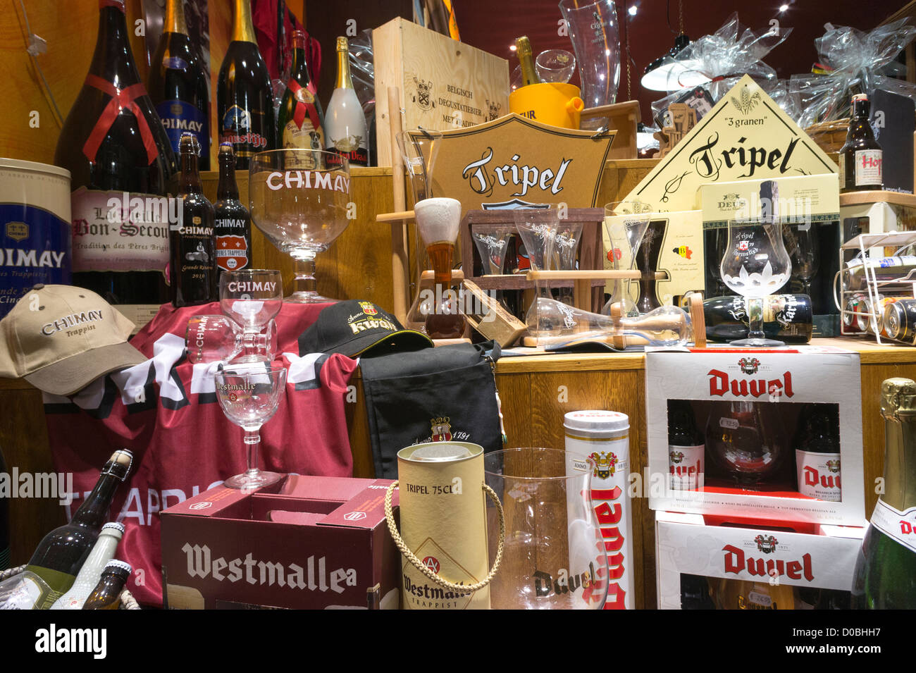 Display of traditional Belgian beers in a shop window in Brussels Belgium.Different brands: Westmalle Chimay Tripel - Stock Image