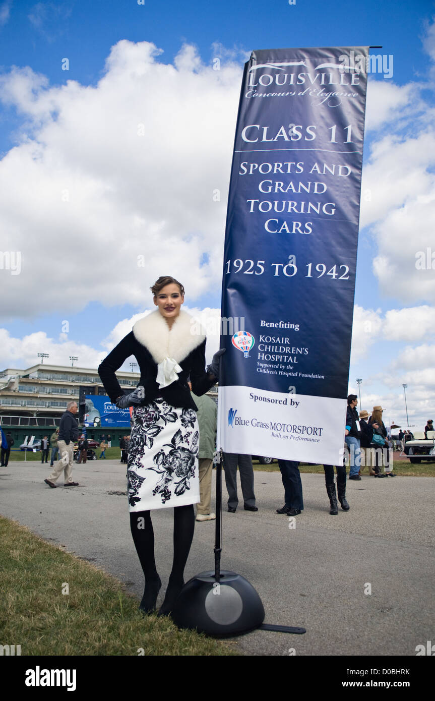 Model in Period Clothing Standing Beside Banner dor the 2012 Concours d'Elegance at Churchill Downs in Louisville, - Stock Image