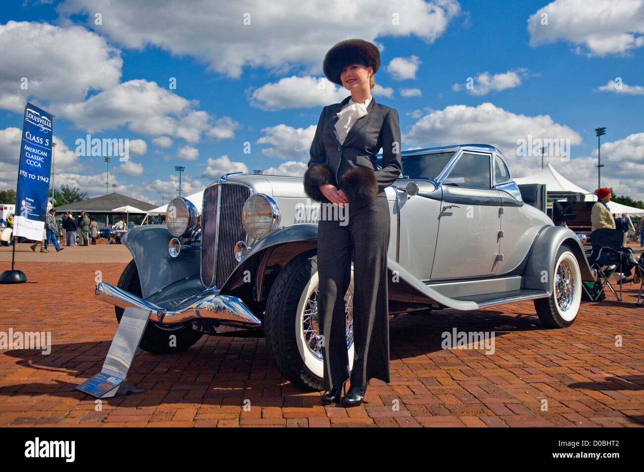 Model in Period Clothing Posing beside 1933 Auburn Salon Convertible Coupe at the Concours d'Elegance at Churchill - Stock Image