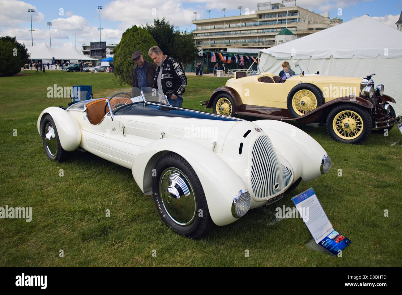 Two Men Looking at a 1931 Alfa Romeo 6C 1750 Gran Sport Aprile Spider at the 2012 Concours d'Elegance at Churchill - Stock Image