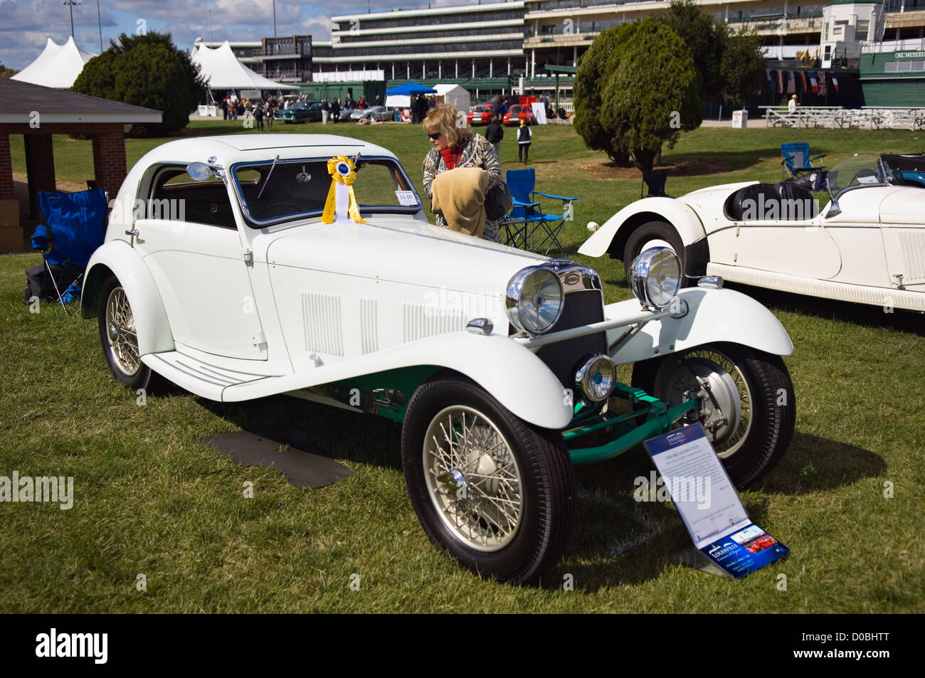 Woman Looking at a 1938 HRG Airline Coupe at the 2012 Concours d'Elegance at Churchill Downs in Louisville, - Stock Image