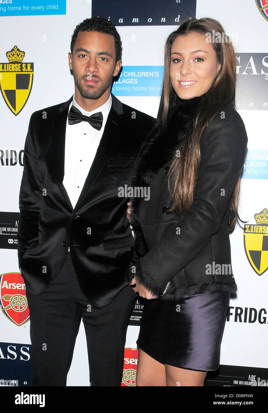 Fulham striker Mousa Dembele and girlfriend arriving at ABC for SOS Ball London, England - 05.12.10 Stuart - Stock Image