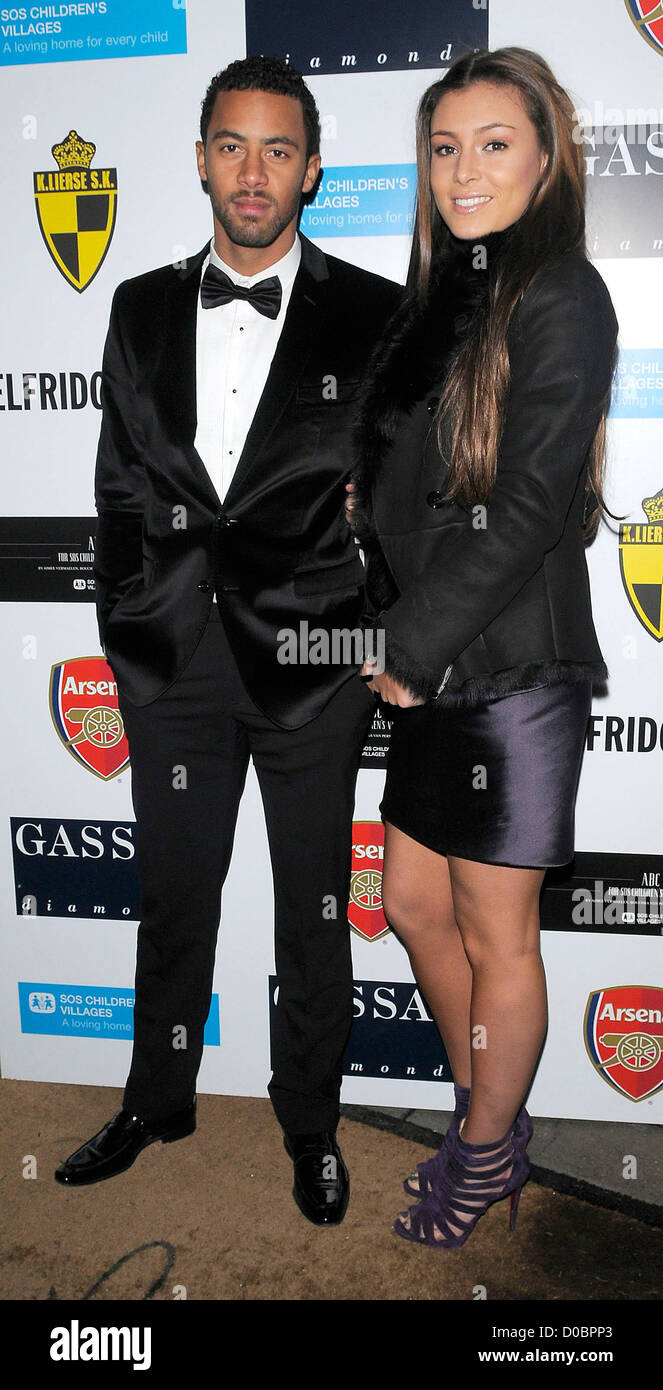 Fulham striker Mousa Dembele and girlfriend arriving at ABC for SOS Ball. London, England - 05.12.10 - Stock Image