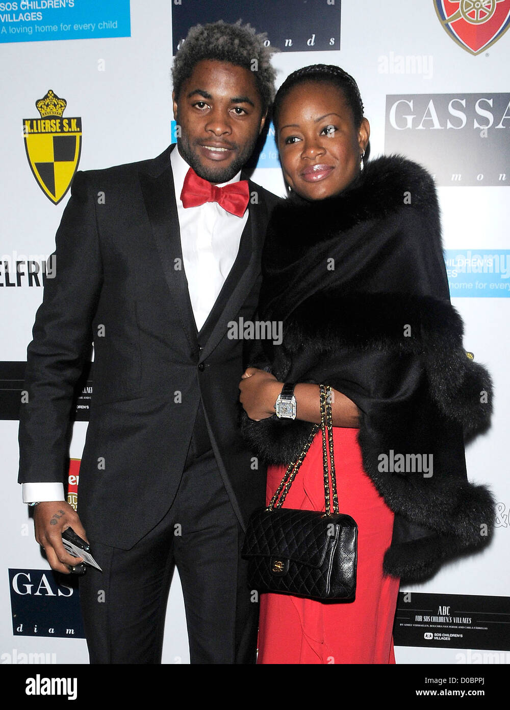 Arsenal's holding midfielder Alex Song Billong and his girlfriend arriving at ABC SOS Ball. London, England - Stock Image