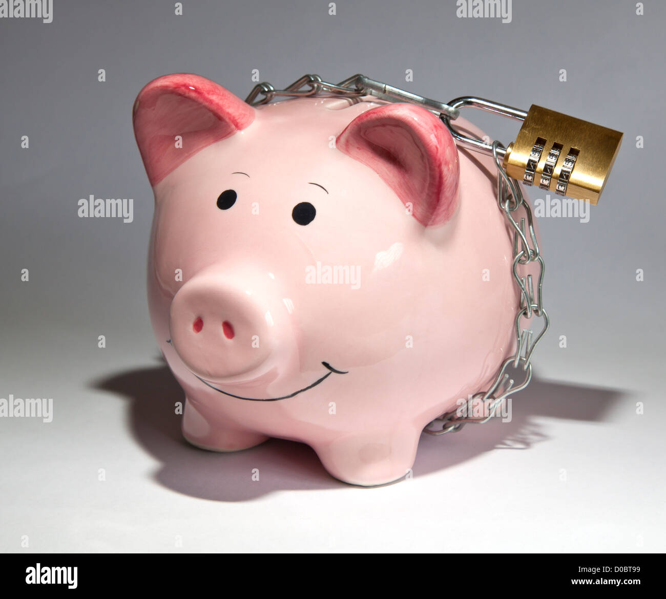 Piggy bank savings locked up Stock Photo