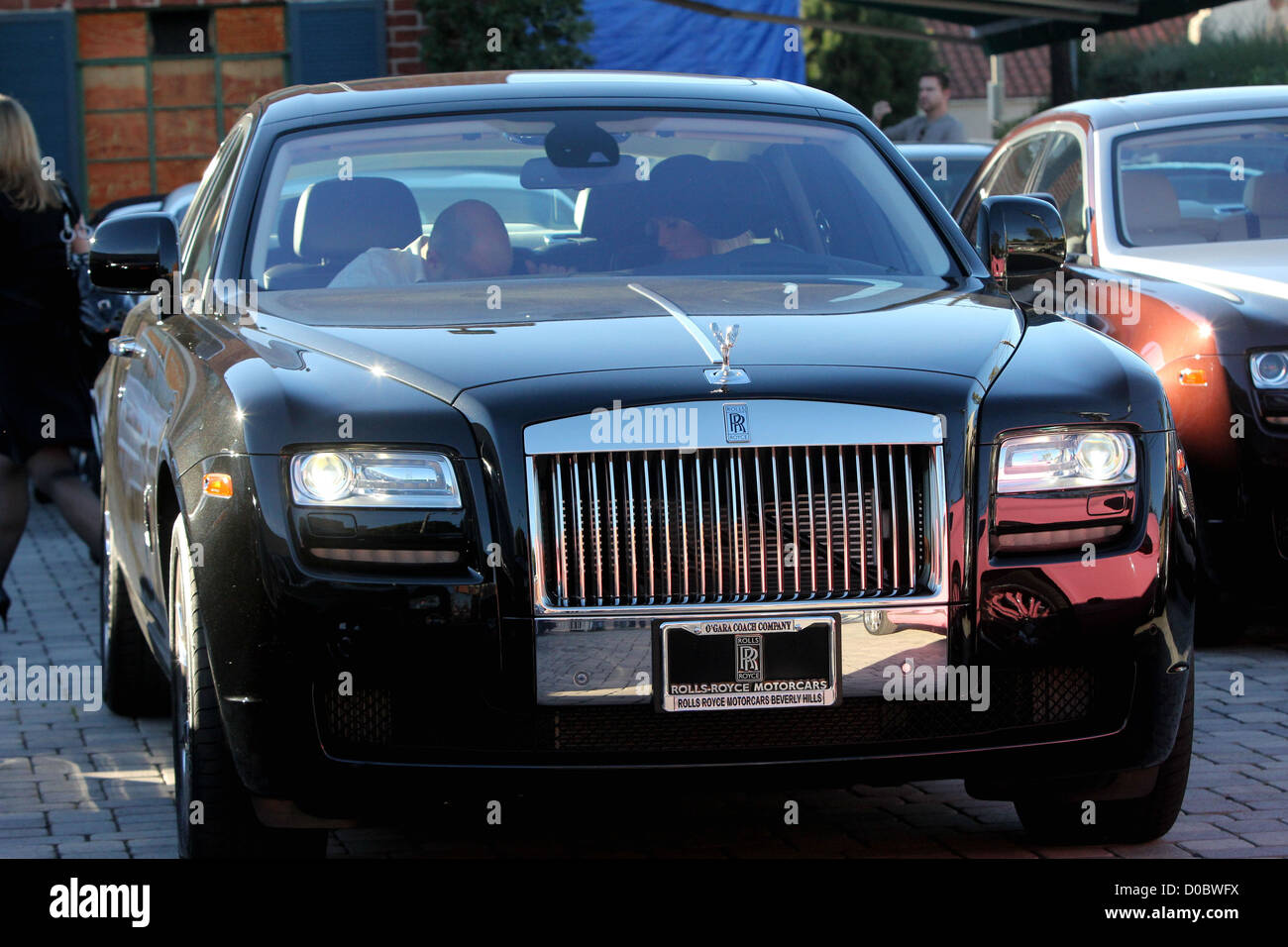 Paris Hilton Picks Up Her New Rolls Royce Ghost From A Luxury Car