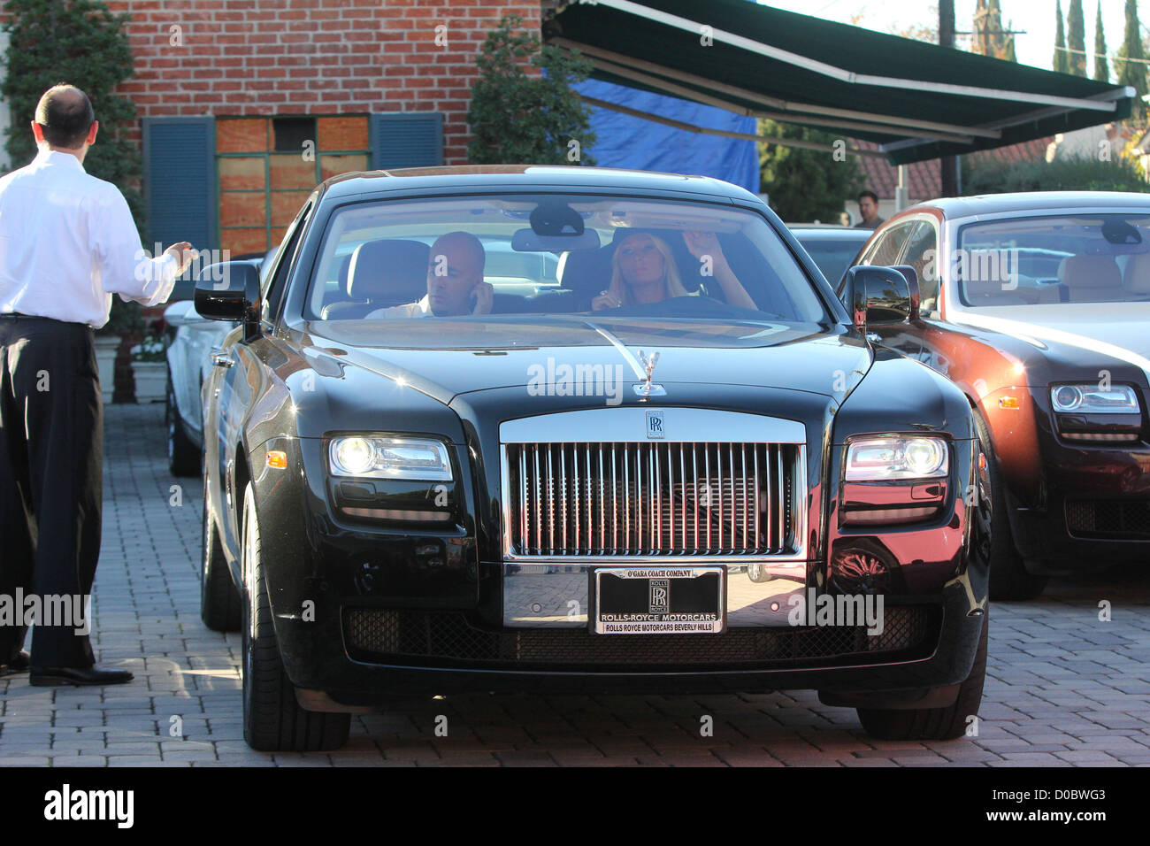 Paris Hilton Picks Up Her New Rolls Royce Ghost From Luxury Car
