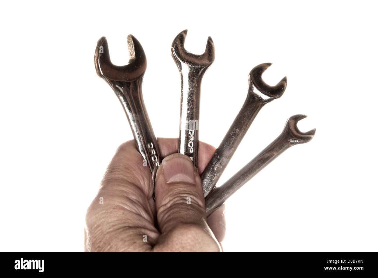 hand holding a set of spanners - Stock Image