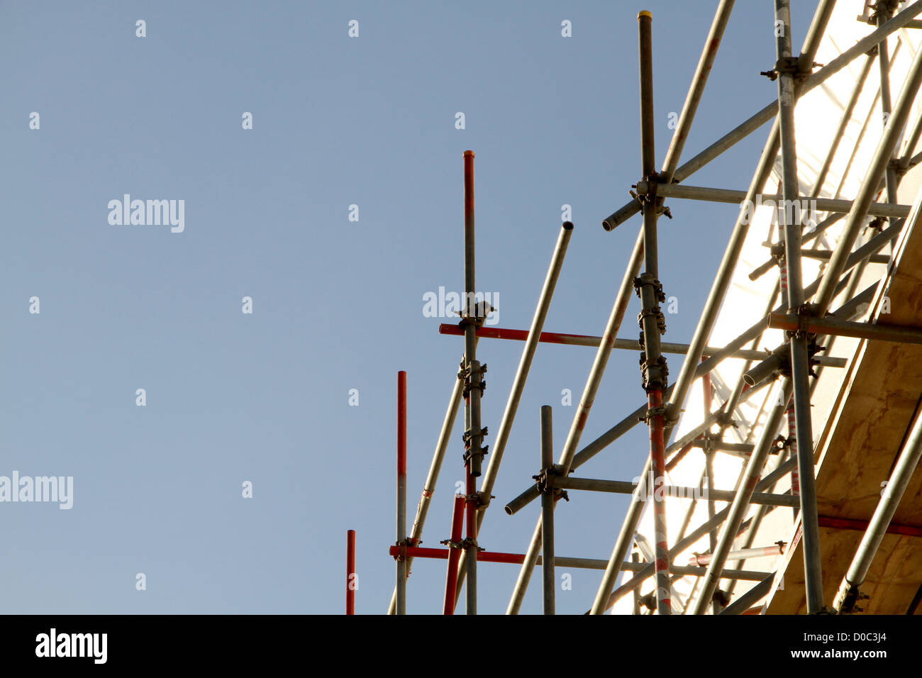 scaffolding against clear blue sky - Stock Image