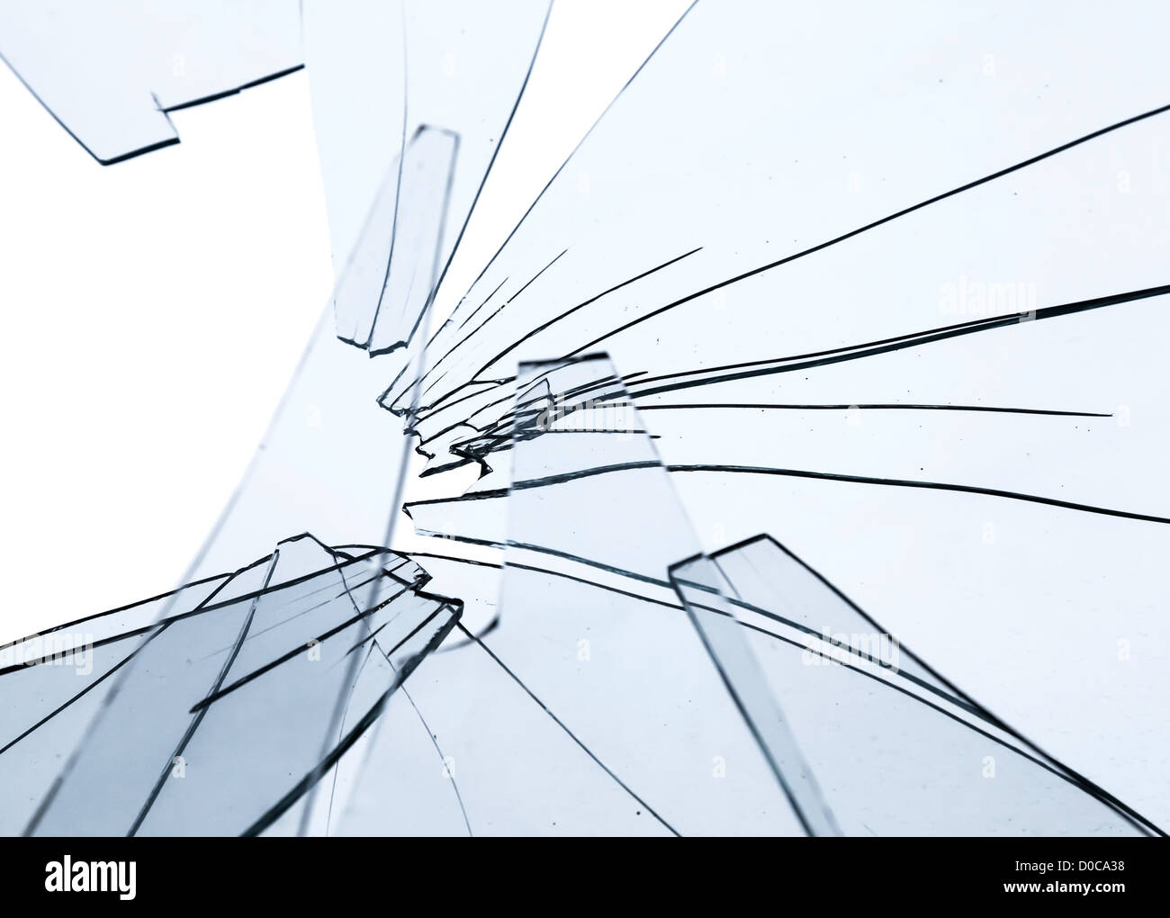 Broken glass fragments above white. Abstract background texture - Stock Image
