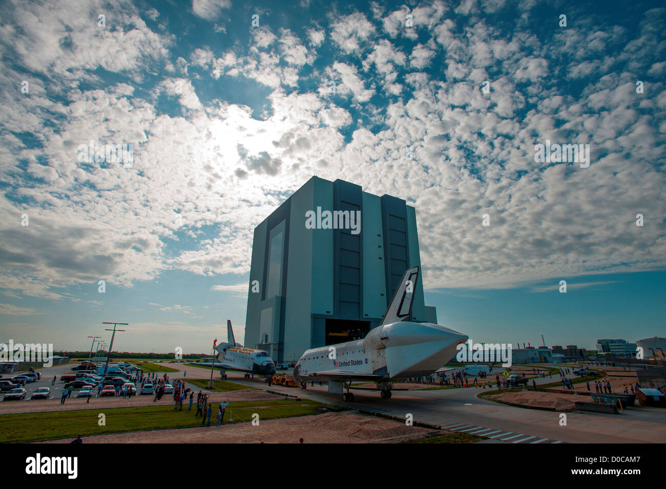 The Space Shuttle Atlantis is seen as it is moved between Vehicle Assembly Building Orbiter Processing Facility - Stock Image