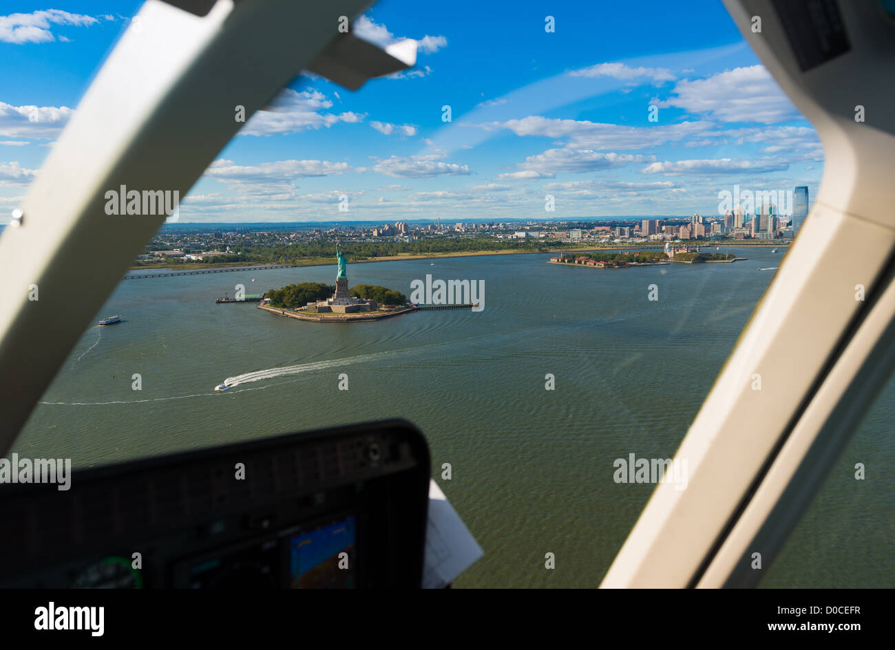 Statue of Liberty and Hudson river view from the window of helicopter, New York - Stock Image