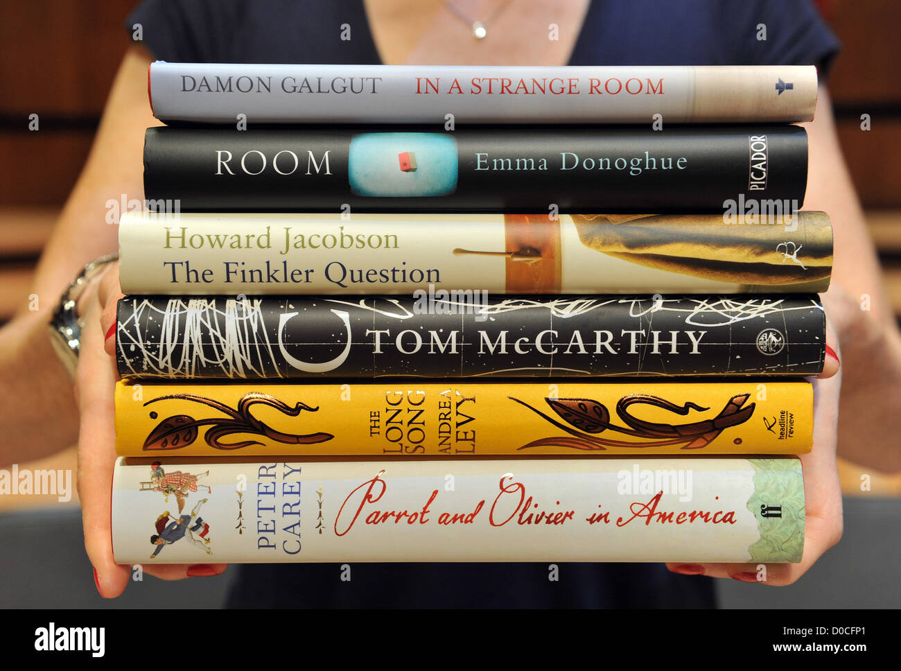Peter Carey 'Parrot and Olivier in America' Emma Donoghue 'Room' Damon Galgut 'In a Strange - Stock Image
