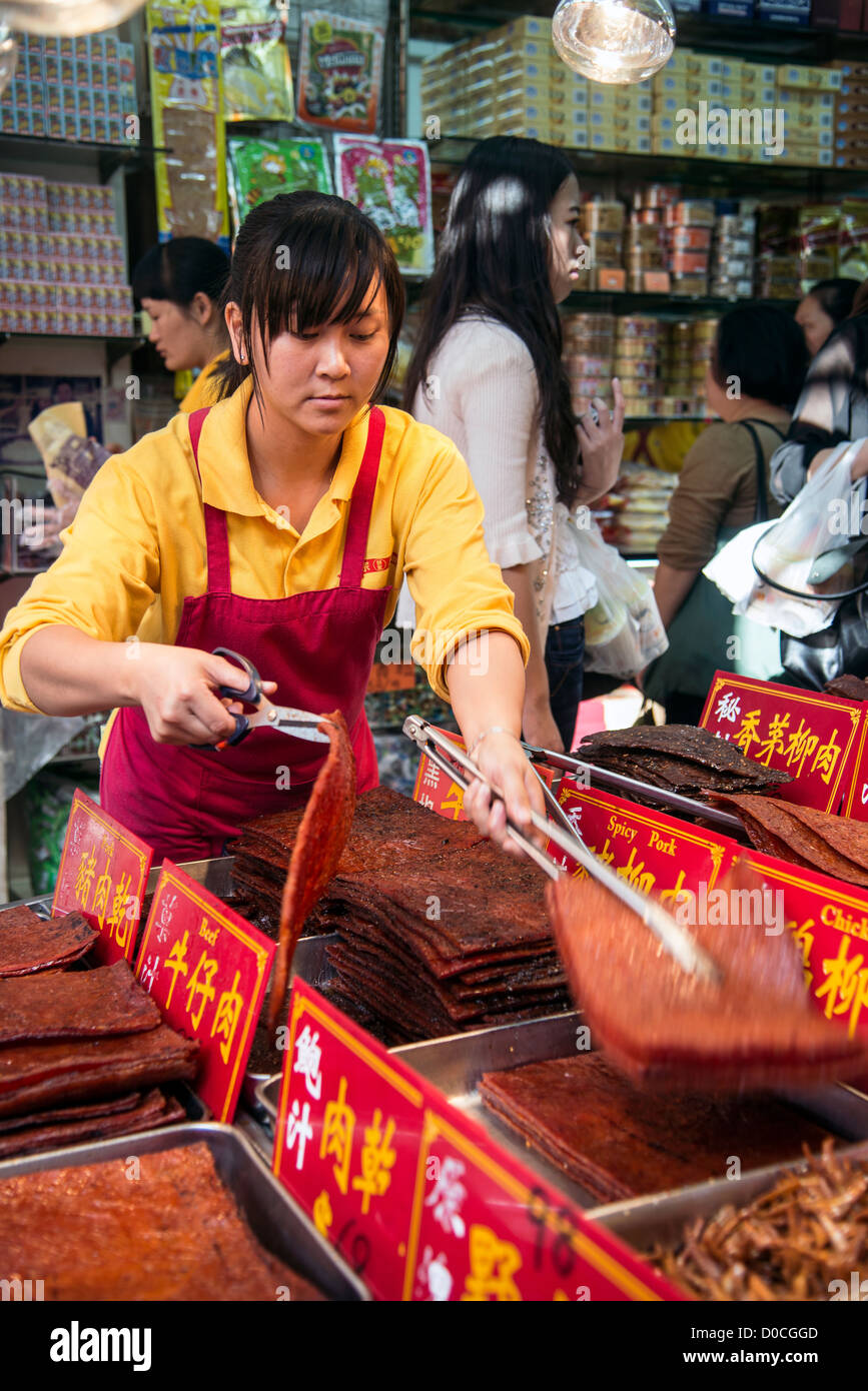Dried meat seller in Macau, China - Stock Image